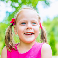 Summer portrait of happy cute child