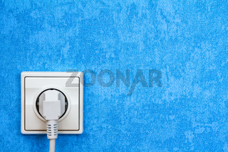 Blue wall with electric socket