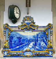 Station clock and hand-painted ceramic tiles, azulejos, at the Pinhao train station, Douro Valley