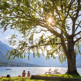 Couple enjoying beautiful nature around lake Bohinj, Slovenia.