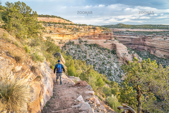 Hiker on a steep trail in Colorado National Monument