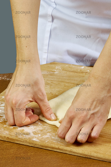 Woman rolls squeezes dough Handmade Series Food recipes
