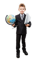 Child boy in business suit holding Earth globe and book