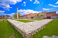Old roman ruins and colorful architecture in town of Nin