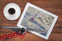 Riding fat bike on desert trail - aerial view