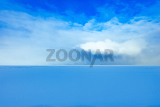 Frozen surface of Baikal lake under the snow at sunny day time.