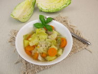 Vegetable stew with cone cabbage in soup bowl