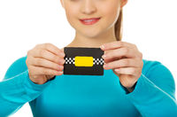 Young woman holding paper card.