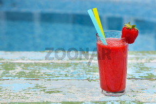 Strawberry smoothie on old rusric turquiose background