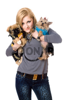 Smiling blonde posing with two dogs. Isolated