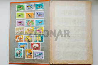 UZHGOROD, UKRAINE - CIRCA APRIL, 2016: Collection of postage stamps in album from Vietnam shows the different types of birds, flowers and animals, circa 1979