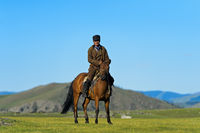Horseman in the steppe, Orkhon Valley, Mongolia