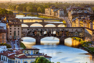 Arno River and the Ponte Vecchio bridge in Florence at sunset