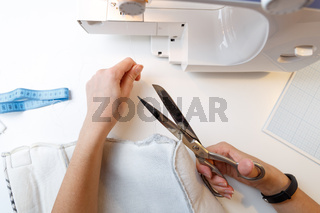 Woman background of sewing machine