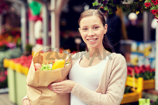 woman with bag of food at street market