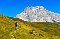 Hiker in front of the peak Sulzfluh, St. Antönien, Prättigau, Graubünden, Grisons, Switzerland