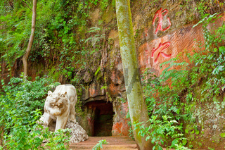 tiger carving outside a cave in Leshan