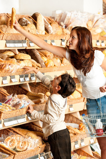Grocery store shopping - Young woman with child