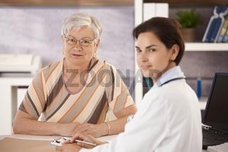 Female pensioner at doctors office