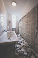 bathroom renovation - removing tiles in old apartment bathroom