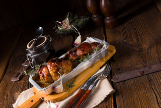 small Rolling roasts fully with dried fruit and bacon