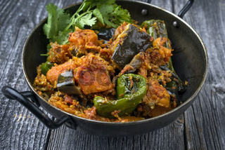 Indian Vegetable Curry Fry with Sweet Potatos and Eggplant  as close-up in a Korai