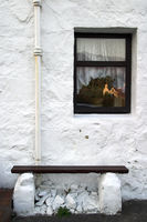 Old white stone house, close up of window