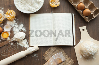 Cooking some tasty food and writing down recipe In open clear note. With ingredients like eggs