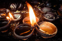 Burning oil lamps at temple