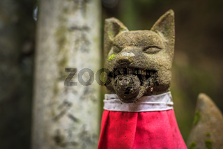 Fox sculpture in Fushimi Inari Shrine, Kyoto, Japan