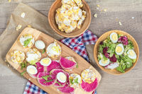Nutritious grain breads with red radish and salad.