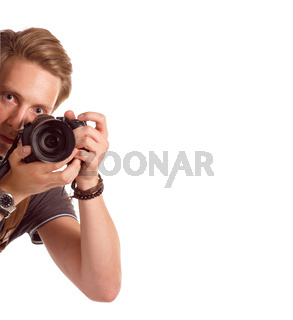 Closeup portrait of a young man taking a picture from corner