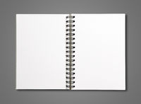 Blank open spiral notebook isolated on dark grey