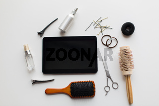 tablet pc, scissors, brushes and other hair tools
