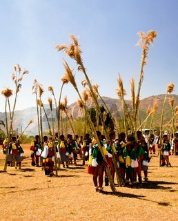 Women in traditional costumes marching at Umhlanga aka Reed Dance 01-09-2013 Lobamba, Swaziland
