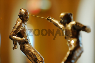 The fencing statues in action of attacking