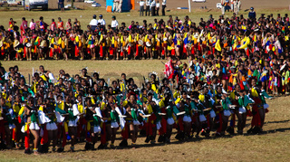 Women in traditional costumes dancing at the Umhlanga aka Reed Dance for their king Lobamba, Swaziland