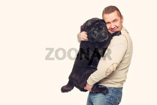 Man with sharpei dog