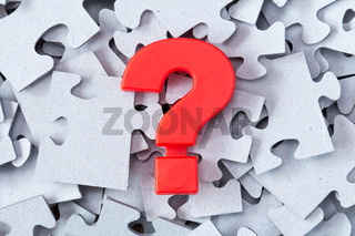Puzzle and red question mark