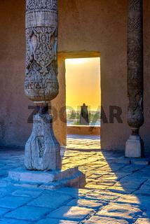Pillars, door and minaret in sunset, Khiva