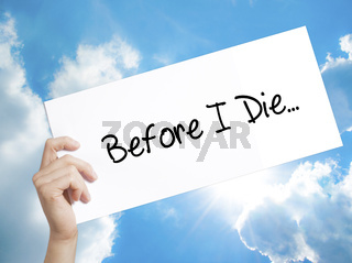 Before I Die..Sign on white paper. Man Hand Holding Paper with text. Isolated on sky background.