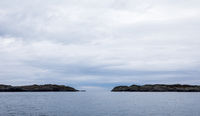 The Rovaer archipelago in Haugesund, in the norwegian west coast. Ocean, islands and sky with clouds.