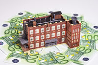 Factory building and banknotes