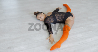 Girl stretching on floor