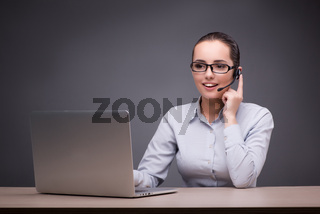 Call center operator working at her desk