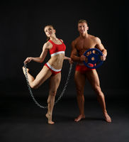 Sexy sporty couple posing in studio