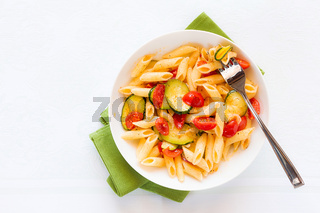 Italian penne pasta with zucchini and cherry tomatoes