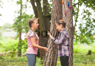Two girls are playing