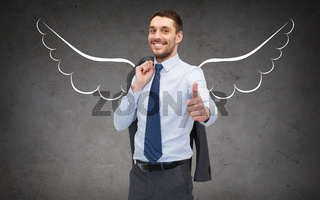 businessman with angel wings showing thumbs up