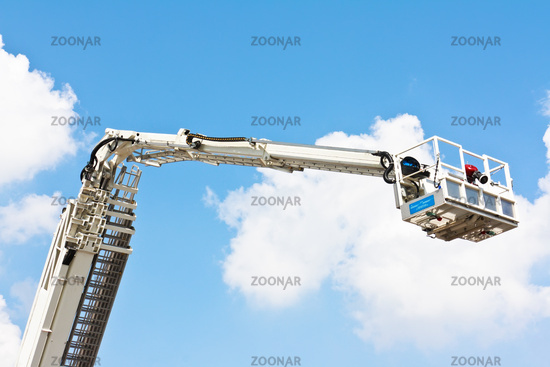 Articulated aerial hydraulic platform against a blue sky